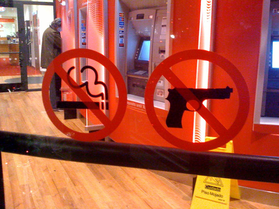 No smoking guns. (Also, guy with face mask?)